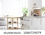 stylish kitchen interior... | Shutterstock . vector #1084729079