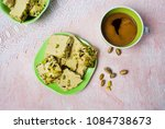 Small photo of Pistachio halva dessert on a plate served with coffee