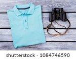light blue folded polo t shirt... | Shutterstock . vector #1084746590