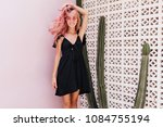 adorable woman in stylish... | Shutterstock . vector #1084755194