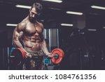 sexy strong bodybuilder... | Shutterstock . vector #1084761356