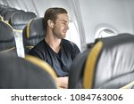 pleased man sits in the... | Shutterstock . vector #1084763006