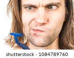 shaving. man body treatment of... | Shutterstock . vector #1084789760