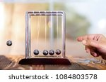 Small photo of Concept For Action and Reaction or Cause And Result in Business With Newton's Cradle