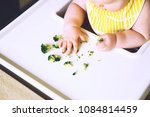 baby's first solid food. messy... | Shutterstock . vector #1084814459