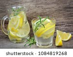 lemon water with rosemary and... | Shutterstock . vector #1084819268