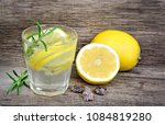 water with lemon and rosemary... | Shutterstock . vector #1084819280