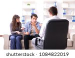 family visiting psychologist... | Shutterstock . vector #1084822019
