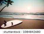 surfboard on tropical beach at... | Shutterstock . vector #1084842680