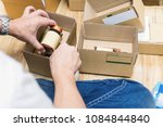 employees are packing a parcel... | Shutterstock . vector #1084844840