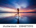 Woman In Bikini Running On The...
