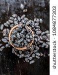 organic dry fruit dried black... | Shutterstock . vector #1084877303
