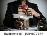 businessman giving money... | Shutterstock . vector #1084877849