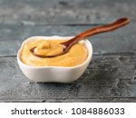 freshly made mustard seed sauce ... | Shutterstock . vector #1084886033