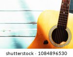 acoustic guitar on wood... | Shutterstock . vector #1084896530