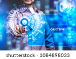 Small photo of Business, Technology, Internet and network concept. Young businessman working on a virtual screen of the future and sees the inscription: Objective