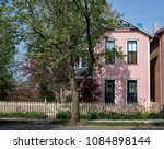 pink house with blue trim  ... | Shutterstock . vector #1084898144