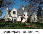 large cream shake sided house... | Shutterstock . vector #1084898798