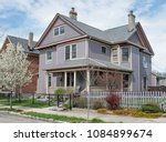 lavender victorian house with... | Shutterstock . vector #1084899674