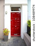 red entrance door in front of... | Shutterstock . vector #108489974