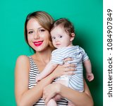 young mother and child on green ...   Shutterstock . vector #1084907849