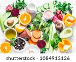 Small photo of Five best vitamins for beautiful skin. Products with vitamins A, B, C, E, K - broccoli, sweet potatoes, orange, avocado, spinach, peppers, olive oil, dairy, beets, cucumber, beans. Flat lay, top view