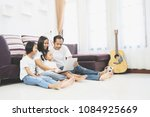 happy asian family and little... | Shutterstock . vector #1084925669