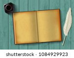 paper notepad and feather with... | Shutterstock .eps vector #1084929923