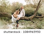 a beautiful couple in the boo... | Shutterstock . vector #1084965950