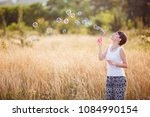 young woman creates soap... | Shutterstock . vector #1084990154