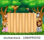 animals with wood blank sign in ... | Shutterstock .eps vector #1084990550