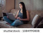 girl working with laptop at home | Shutterstock . vector #1084990808