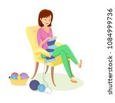 cheerful woman knits a scarf... | Shutterstock .eps vector #1084999736