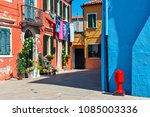 red  orange and blue houses... | Shutterstock . vector #1085003336