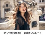 happy stylish woman smiling in... | Shutterstock . vector #1085003744