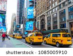 Small photo of New York - April 10,2018 : Taxi cab or Yellow cab running in a street next to Times Square