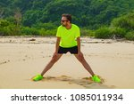 exercising on a tropical sandy... | Shutterstock . vector #1085011934