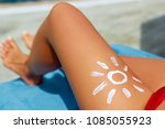 closeup  female  leg with sun... | Shutterstock . vector #1085055923