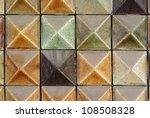 Brown mosaic tiles background texture - stock photo