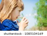 child glass of water. selective ... | Shutterstock . vector #1085104169