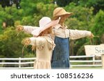 2 Scarecrows Stand Together In...