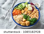 nourishing buddha bowl with... | Shutterstock . vector #1085182928