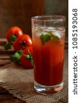 red tomato juice in a glass | Shutterstock . vector #1085193068