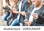 Stock photo  multicultural friends group using smartphone at university college break millenial people hands 1085196659
