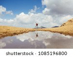 single hiker jumps outdoor. ... | Shutterstock . vector #1085196800