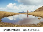 hiker passing mountain plash | Shutterstock . vector #1085196818