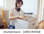young audiophile browses... | Shutterstock . vector #1085196968