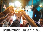 Stock photo group of happy friends drinking and toasting beer at brewery bar restaurant friendship concept 1085215253