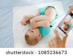 parent taking photo of a baby... | Shutterstock . vector #1085236673