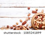 mixed nuts in wooden bowl and... | Shutterstock . vector #1085241899